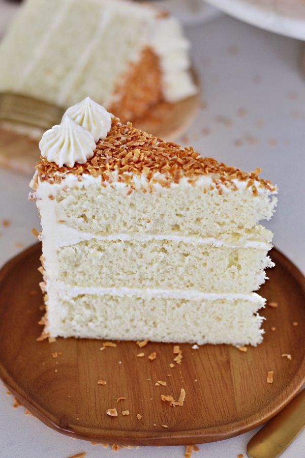Coconut Cream Cake #cakebycourtney #coconutcreamcake #coconutcake #easycoconutcake #coconutcakerecipe #coconutbuttercream