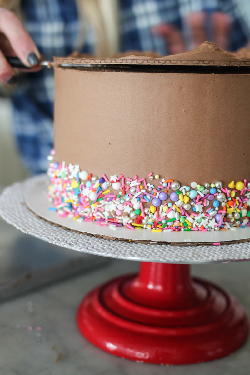 Smoothing The Sides Of Cake Frosting