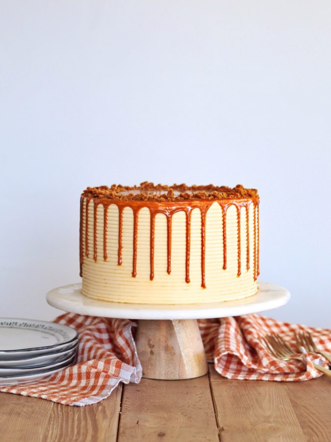 Banana Caramel Biscoff Cake: banana cake layers with caramelized bananas, Biscoff filling and caramel frosting #cakebycourtney #bananacake #biscoffcake #caramelcake #caramelfrosting #caramelbuttercream #carameldrip #banana #biscoff #easycakerecipe #fruitcakerecipe #frostingrecipe #bestcaramelfrosting #bestcaramelbuttercream