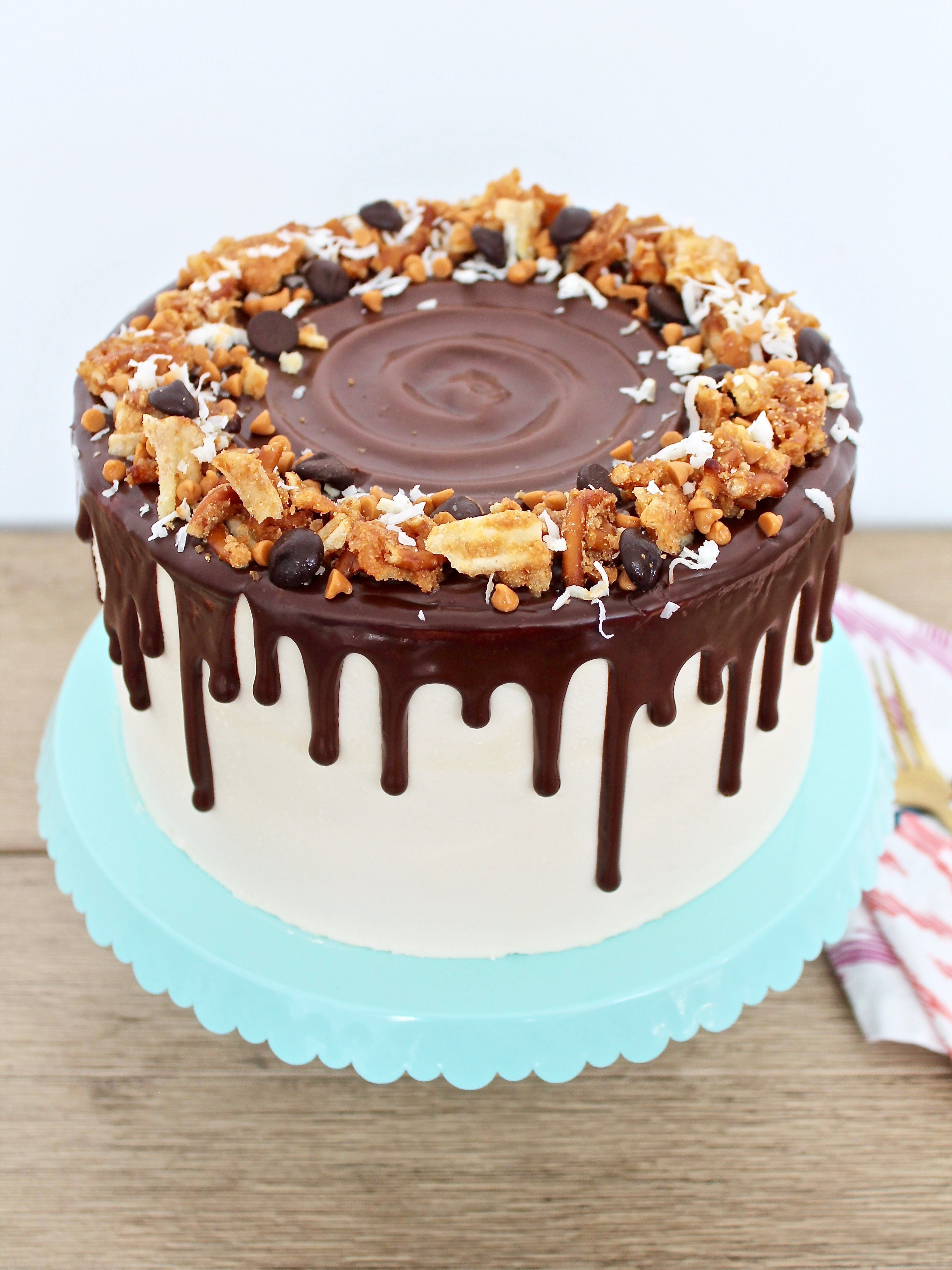 with potato chips and pretzels baked into a toffee like bark for the filling combined with chocolate chips     everything but the kitchen sink cake   cake by courtney  rh   cakebycourtney com