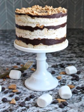 Marshmallow Moon Pie Cake - vanilla cake layers, marshmallow filling, graham cracker crumble, chocolate ganache and graham cracker frosting #cakebycourtney #moonpie #moonpiecake #marshmallowmoonpiecake #cake