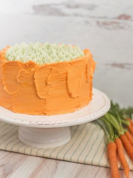 Carrot Apricot Cake - carrot ginger cake layers with white chocolate buttercream, apricot filling and a pretzel crunch #cakebycourtney #carrotcake #whitechocolatebuttercream #cake #eastercake #carrotcakeforeaster #easterdessert