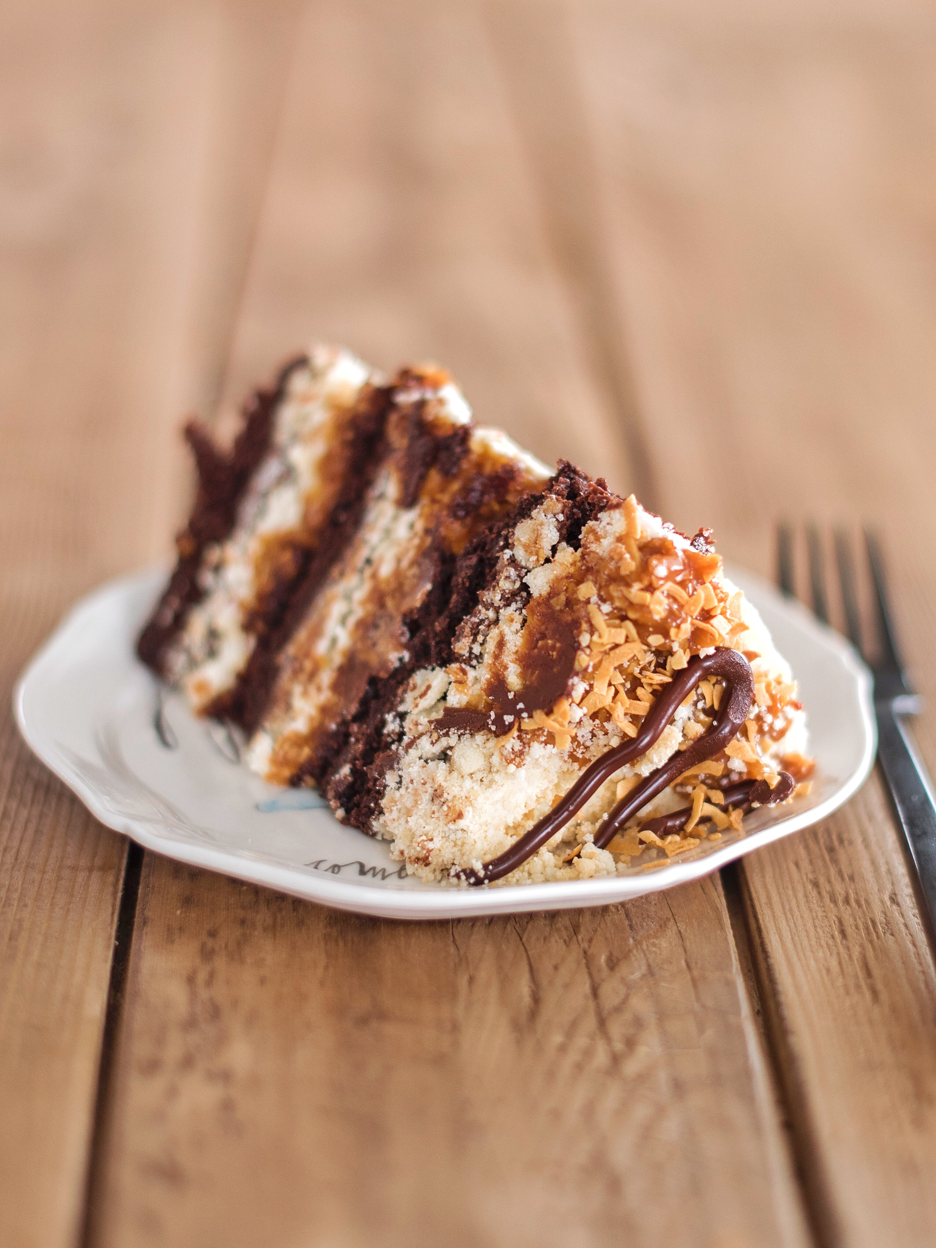 Samoa Girl Scout Cookie Cake: delicious dark chocolate cake, caramel coconut filling, shortbread crumbs and shortbread buttercream #cakebycourtney #samoa #girlscoutcookiecake