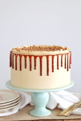 Dark Chocolate Salted Caramel Cake: dark chocolate cake layers with salted caramel frosting and caramel drip. #cakebycourtney #chocolatecake #bestchocolatecake #saltedcaramel #caramel #chocolate #caramelcake #cakebycourtney