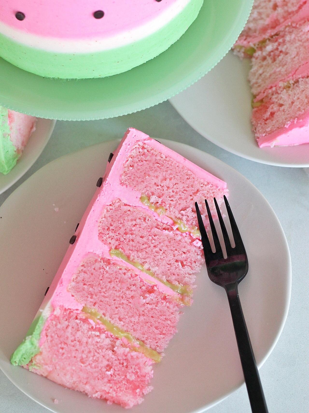 Watermelon Lime Cake: white cake layers with a watermelon simple syrup, lime curd and watermelon buttercream. #cakebycourtney #cake #cakerecipe #summercakes #cakes #watermeloncake #limecurd