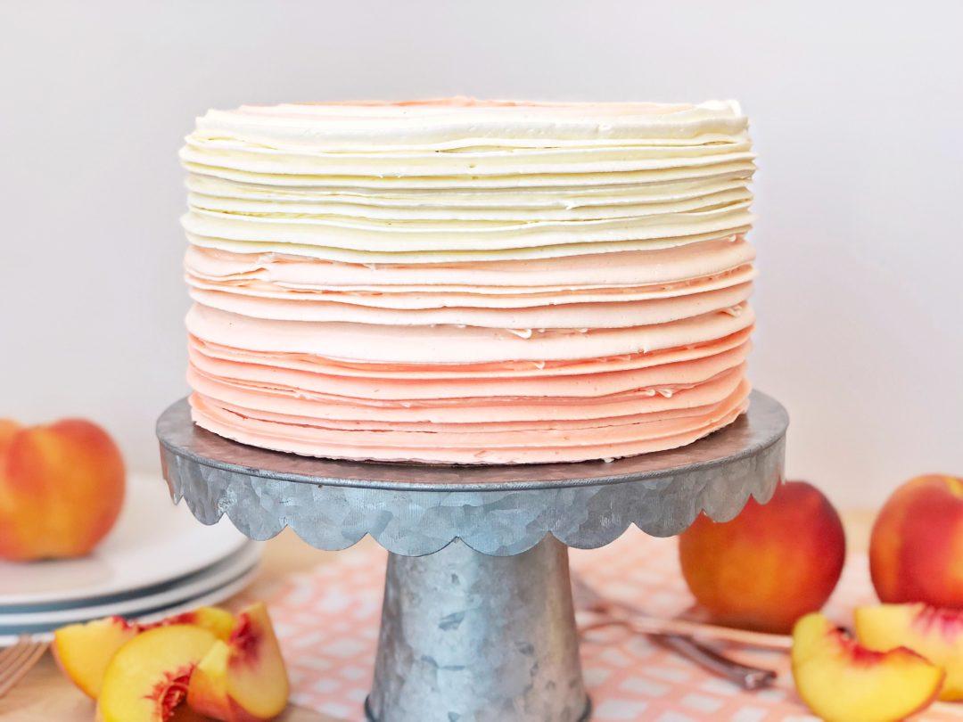 Peaches and Cream Cake - layers of peach cake with peaches and cream filling and vanilla buttercream. #peachcake #peachesandcreamcake #peachdessert #buttercreamrecipe #vanillabuttercreamrecipe #howtomakecake #howtomakebuttercream #howtomakebuttercreamfrosting #icingrecipe #cakerecipe #summercakerecipe
