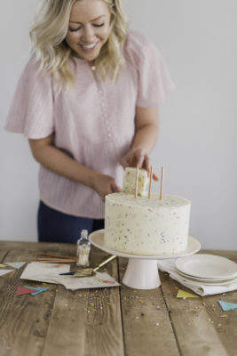 Classic Confetti Cake - tender and fluffy vanilla cake layers, filled with sprinkles and covered with a whipped vanilla buttercream. #confetticake #birthdaycake #bestbirthdaycake #funfetticake #birthdaycakerecipe #vanillabuttercream #cakebycourtney