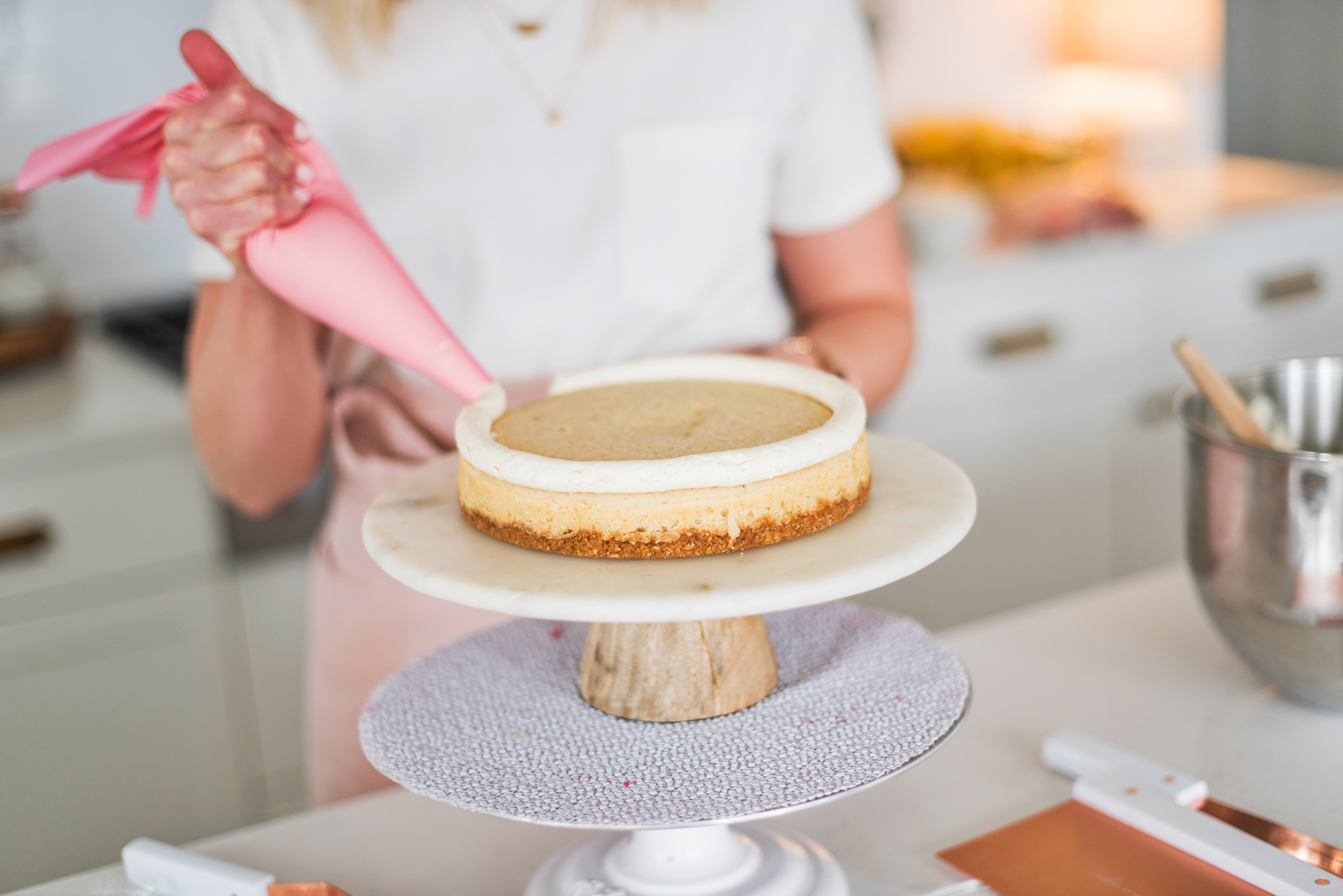 Creme Brûlée Cake: vanilla bean cake layers baked on a graham cracker crust, filled with vanilla bean custard and covered in a vanilla bean buttercream #cakebycourtney #cake #cremebrulee #cremebruleecake #cakerecipe #vanillabeancake #vanillacake