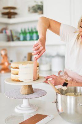 Creme Brûlée Cake: vanilla bean cake layers baked on a graham cracker crust, filled with vanilla bean custard and covered in a vanilla bean buttercream #cakebycourtney #cake #cremebrulee #cremebruleecake #cakerecipe #vanillabeancake #vanillacake