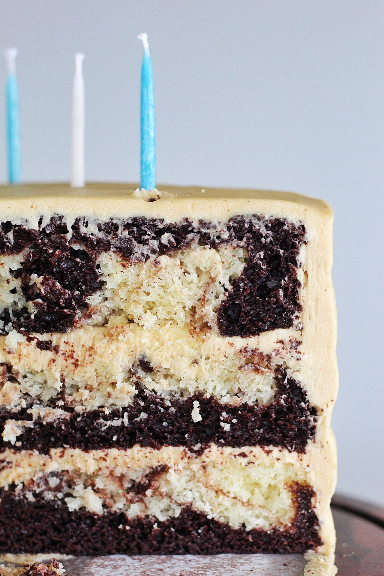 Super Moist Marble Cake: Tender and moist chocolate and vanilla cake are swirled together to make this delicious, from-scratch marble cake that I paired with peanut butter frosting. #cakebycourtney #marblecake #easymarblecakerecipe #cakerecipe #moistcakerecipe #supermoistmarblecake