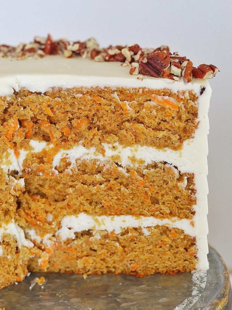 Classic Carrot Cake: incredibly moist, spiced carrot cake layers with a perfectly tangy cream cheese buttercream. #CakebyCourtney #carrotcake #classiccarrotcake #carrotcakewithoutraisins #carrotcakewithoutnuts #carrotcakewithoutnutsorraisins #creamcheesefrosting #creamcheesebuttercream #carrotcakerecipe #thebestcarrotcakerecipe #thebestcarrotcake #eastercake #easterrecipe #easterdessert