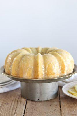 Lemon Poppy Seed Bundt Cake - tender and moist lemon poppy seed cake with a lemon butter glaze #cakebycourtney #cake #lemonbundtcake #lemonpoppyseedcake #lemonpoppyseedbundtcake #easylemoncake #easybundtcake #lemoncake #thebestlemonpoppyseedbundtcake #thebestlemoncake #lemondessert