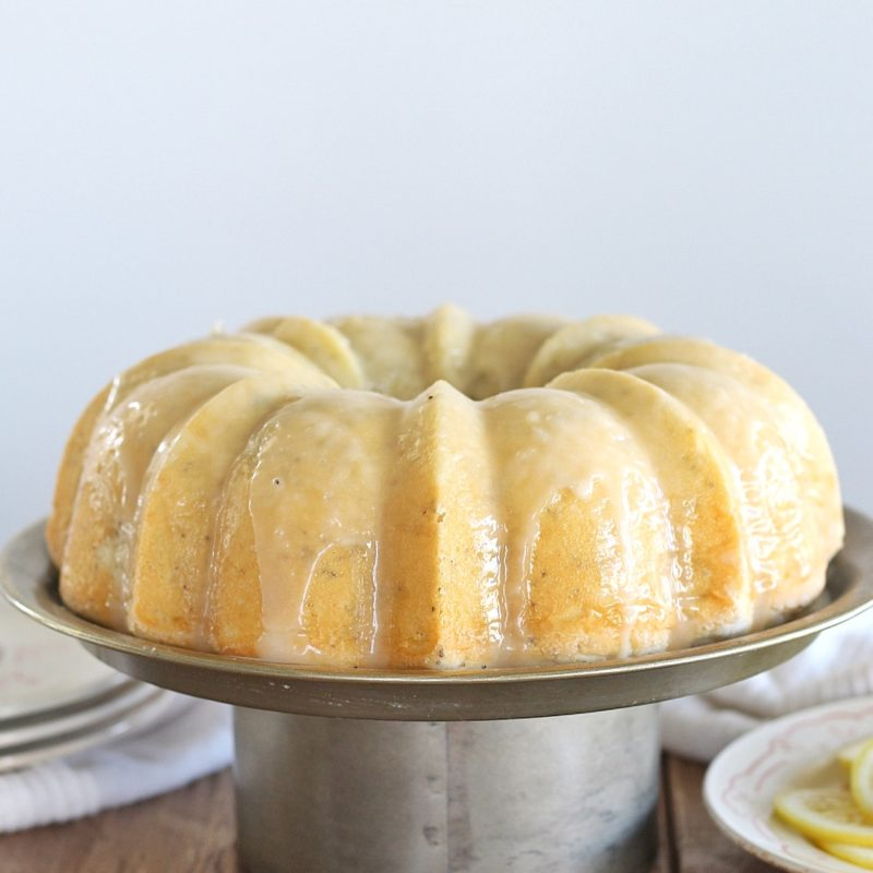 Lemon Poppy Seed Bundt Cake - tender and moist lemon poppy seed cake with a lemon butter glaze #cakebycourtney #cake #lemonbundtcake #lemonpoppyseedcake #lemonpoppyseedbundtcake #easylemoncake #easybundtcake #lemoncake #thebestlemonpoppyseedbundtcake #thebestlemoncake #lemondessert