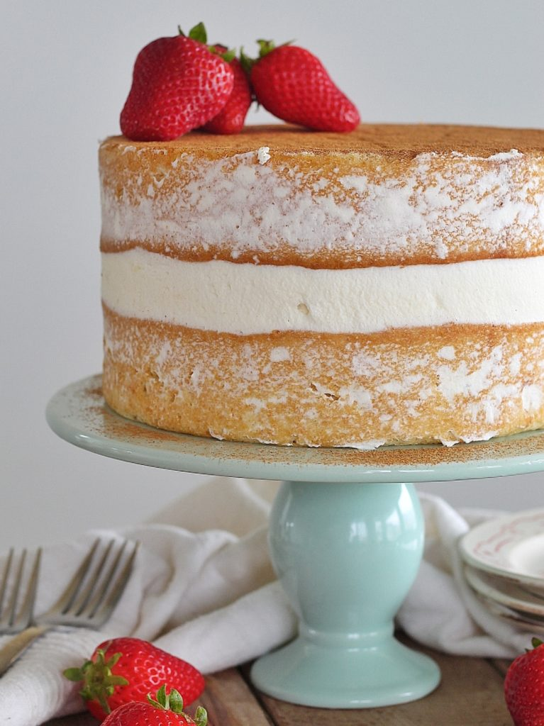 Tres Leches Cake - vanilla sponge cake with a cinnamon soak, whipped cream and fresh strawberries. #cakebycourtney #treslechescake #layeredtreslechescake #cincodemayocake #cincodemayo