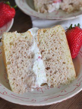 Tres Leches Cake - vanilla sponge cake with a cinnamon soak, whipped cream and fresh strawberries. #cakebycourtney #treslechescake #layeredtreslechescake #cincodemayocake #cincodemayo