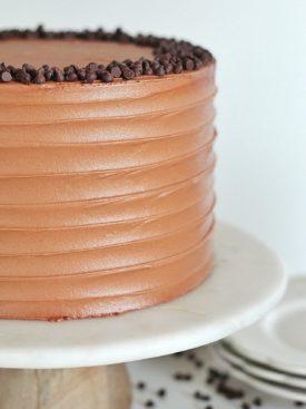 Triple Chocolate Banana Cake: chocolate, chocolate chip banana cake layers with banana cream filling and chocolate buttercream #cakebycourtney #cake #chocolatebananacake #bananacake #bananapudding #chocolatecake #easychocolatecake #moistchocolatecake #bananachocolatecake #bananachocolatebread #banana #chocolate #chocolatebuttercream #magnoliabananapudding