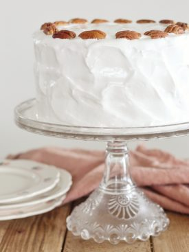 Lady Baltimore Cake - the third cake in my vintage cake series, this Lady Baltimore Cake has the fluffiest white cake layers with a light and fluffy divinity frosting and dried fruit filling. #cakebycourtney #whitecakerecipe #whitecake #ladybaltimorecake
