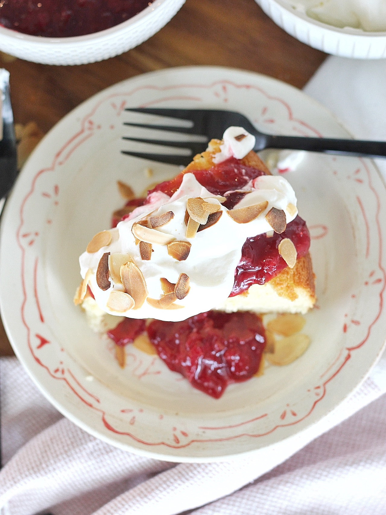 Cherry Almond Cake: tender almond cake layers with a cherry almond compote, buttermilk whipped cream and toasted almonds. #cakebycourtney #cherryalmondcake #classiccake #vintagecake #cakerecipe #easycakerecipe