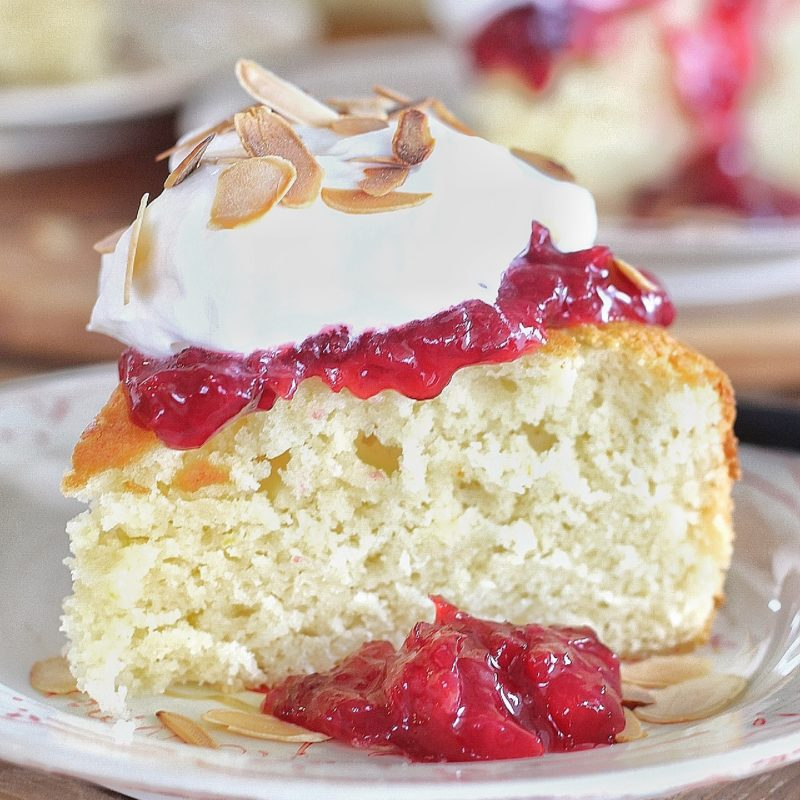 Cherry Almond Cake: tender almond cake layers with a cherry almond compote, buttermilk whipped cream and toasted almonds. #cakebycourtney #cherryalmondcake #classiccake #vintagecake #cakerecipe #easycakerecipe