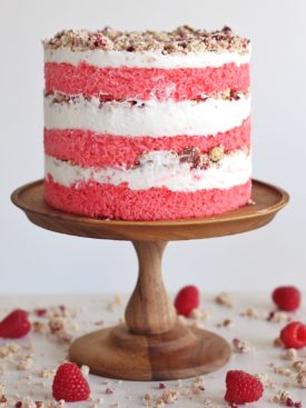Raspberry Pretzel Crunch Cake - inspired by our family's raspberry pretzel salad, this cake is filled with raspberry cake layers, cream cheese frosting and a raspberry pretzel crunch filling. #cakebycourtney #cake #raspberrypretzelcrunchcake #raspberrypretzelsalad