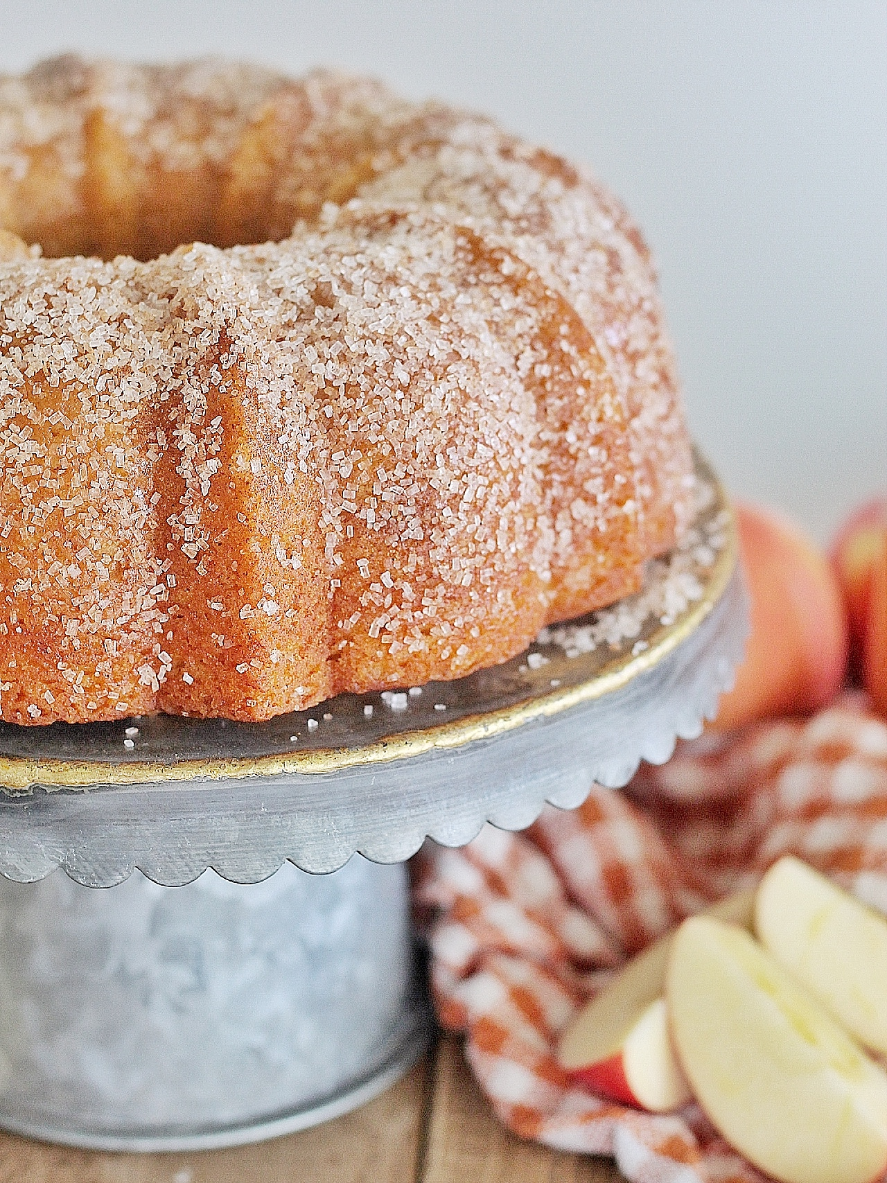 Apple Cider Donut Bundt Cake - a tender and moist apple cinnamon bundt cake with a cinnamon sugar dusting. #cakebycourtney #appleciderdonut #appleciderdonutcake #budntcake #easybundtcakerecipe #fallcake #applecake
