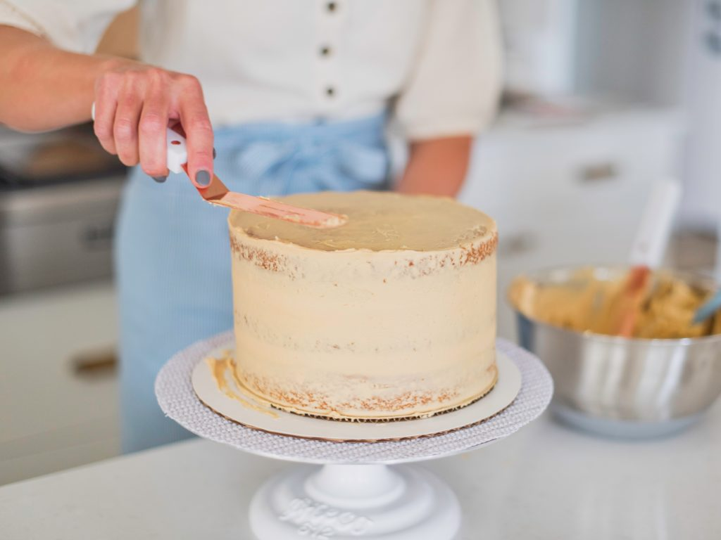 Caramel Cake - the most delicious, moist, flavorful caramel cake layers with caramel and caramel buttercream #caramelcake #cakebycourtney #caramel #buttercream #fallcake