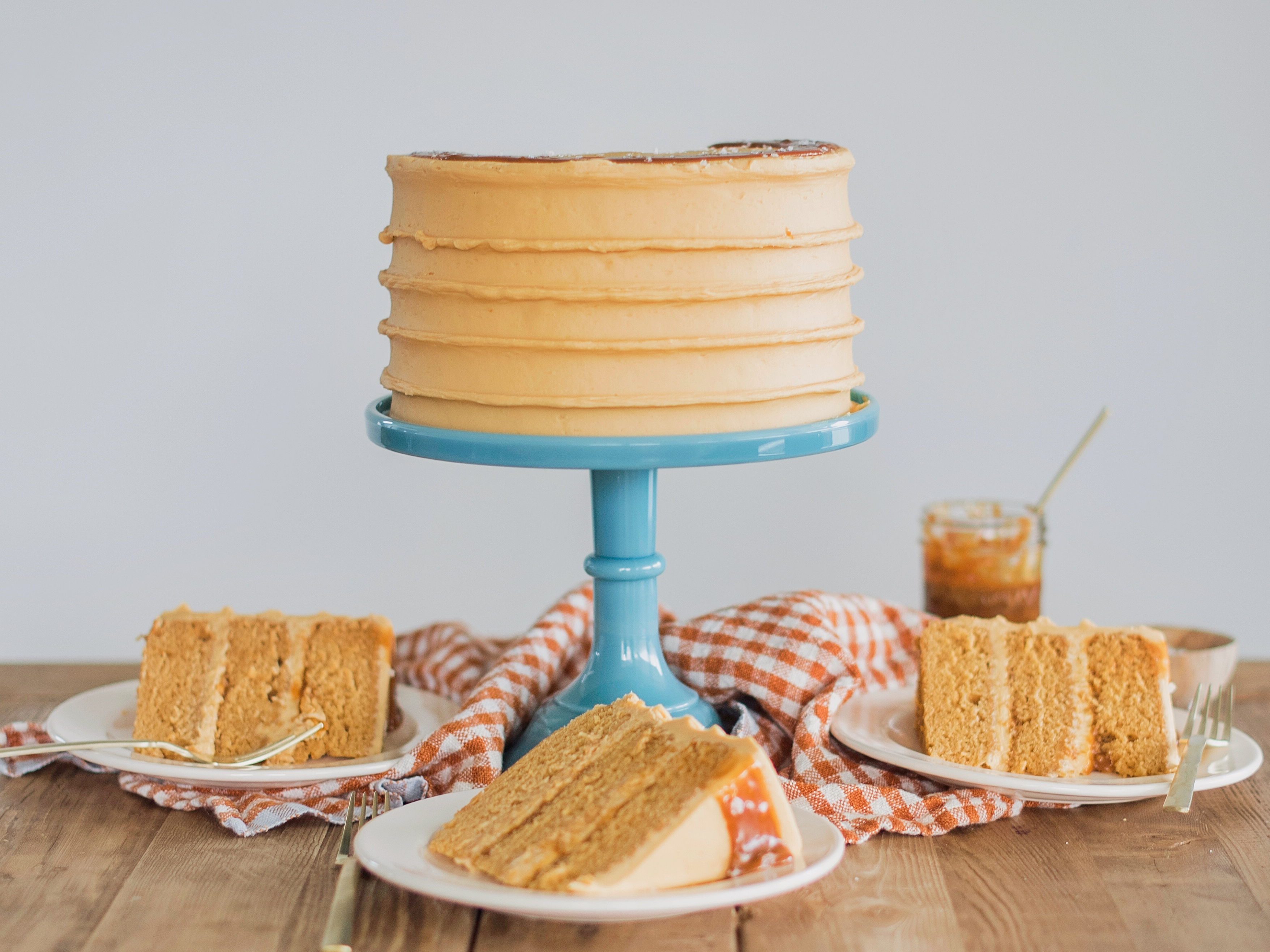 Caramel Cake - caramel cake layers with caramel drizzle and caramel buttercream. #cakebycourtney #caramelcake #cakerecipe #caramelrecipe #caramel #fallcake