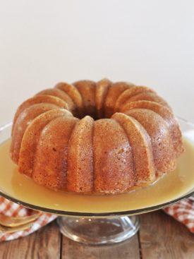 Pumpkin Bundt Cake with Butter Rum Sauce: a moist and flavorful pumpkin cake with a butter rum sauce. #fallcake #cakebycourtney #pumpkincake #bundtcake #pumpkinbundtcake #easybundtcake #easycakerecipe #buttersauce #pumpkindessert