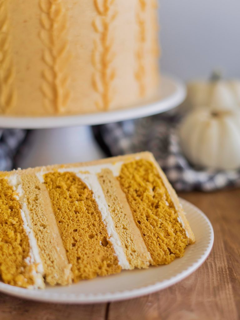 Pumpkin Sugar Cookie Cake - deliciously moist and fluffy pumpkin cake layers, with boiled milk frosting, pumpkin sugar cookies and pumpkin buttercream! #cakebycourtney #pumpkincake #pumpkindessert #desserts #fall #Falldesserts #fallcakeidea #falldessertideas