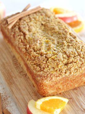 Wassail Crumble Cake - a delicious orange, apple, cinnamon cake loaf with an orange cinnamon crumble and orange glaze. #christmascake #christmascakerecipe #christmasdessertrecipe #christmascakeideas #christmascakeflavors #easychristmascake #christmasdessertideas #easycrhistmasdesserts #christmasdesserts #cakebycourtney #bestholidaycakes