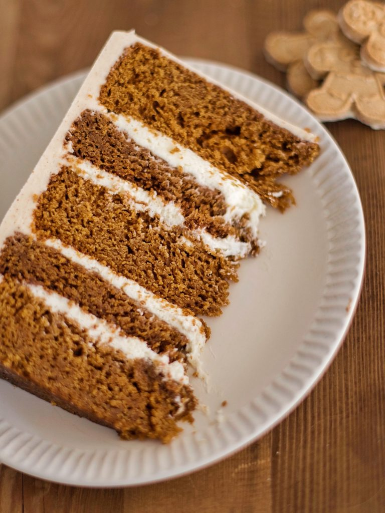 Gingerbread Cookie Cake - gingerbread cake layers with boiled milk frosting, gingersnap cookies and gingersnap buttercream. #gingerbread #gingersnap #boiledmilkfrosting #christmascake #bestchristmascakes #bestholidaycakes #holidaycakes #bestholidaydesserts #holidaydessertideas #holidaycakerecipe #christmascakerecipes #gingerbreadcake #gingersnapcookie
