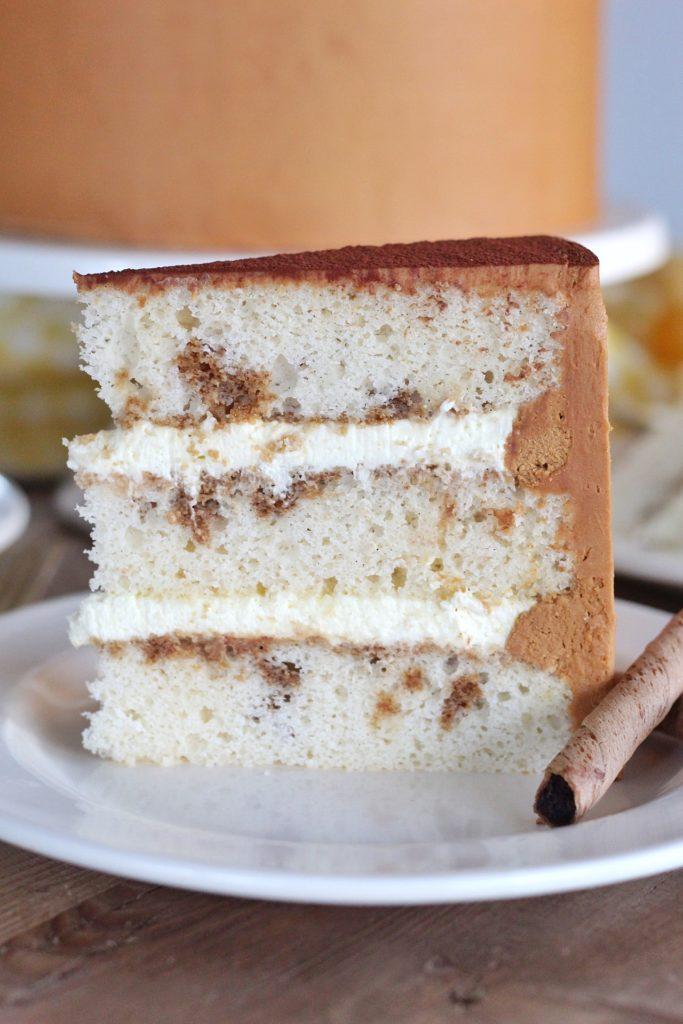 Tiramisu Cake - vanilla bean cake layers with a coffee and rum soak, mascarpone custard and coffee buttercream. #cakebycourtney #tiramisu #tiramisucake #tiramisucakerecipe #tiramisurecipe #cakerecipe #howtomakeatiramisu #coffeebuttercream #buttercreamrecipe #cakerecipe #layeredcake #coffeecake #custardrecipe