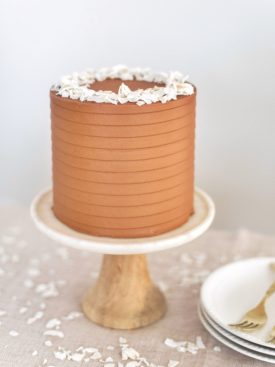 Chocolate Coconut Cake - coconut cake layers with a chocolate coconut buttercream #cakebycourtney #cake #coconutcake #chocolatecoconutcake #cakerecipe #easycakerecipe #chocolatebuttercream #easycoconutcakerecipe #coconutcakerecipe