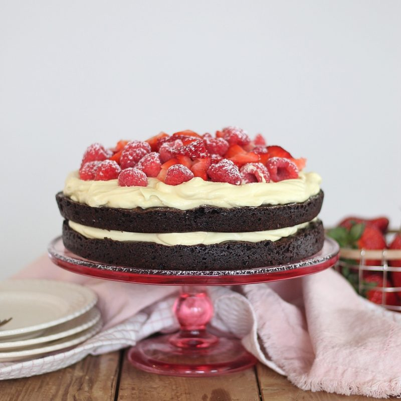 Brownie Berry Torte - decadent brownie layers, topped with a vanilla custard and fresh berries make for the easiest and most delicious, quick-fix dessert. #cakebycourtney #cake #browniecake #brownies #brownieberrytorte #easysbrownierecipe #easydessertrecipe