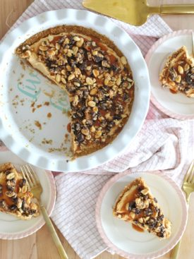 Best Peanut Butter Pie - peanut butter and cream cheese filling on top of a graham cracker and pretzel crust with homemade caramel sauce, peanuts and chocolate peanut butter cups. #peanutbutterpie #peanutbutterpierecipe #bestpeanutbutterpie #bestpierecipe #magnoliabakerypeanutbutterpie #easydessertrecipe #quickdessertrecipe #quickanddeliciousdessertrecipe #pierecipe #cakebycourtney