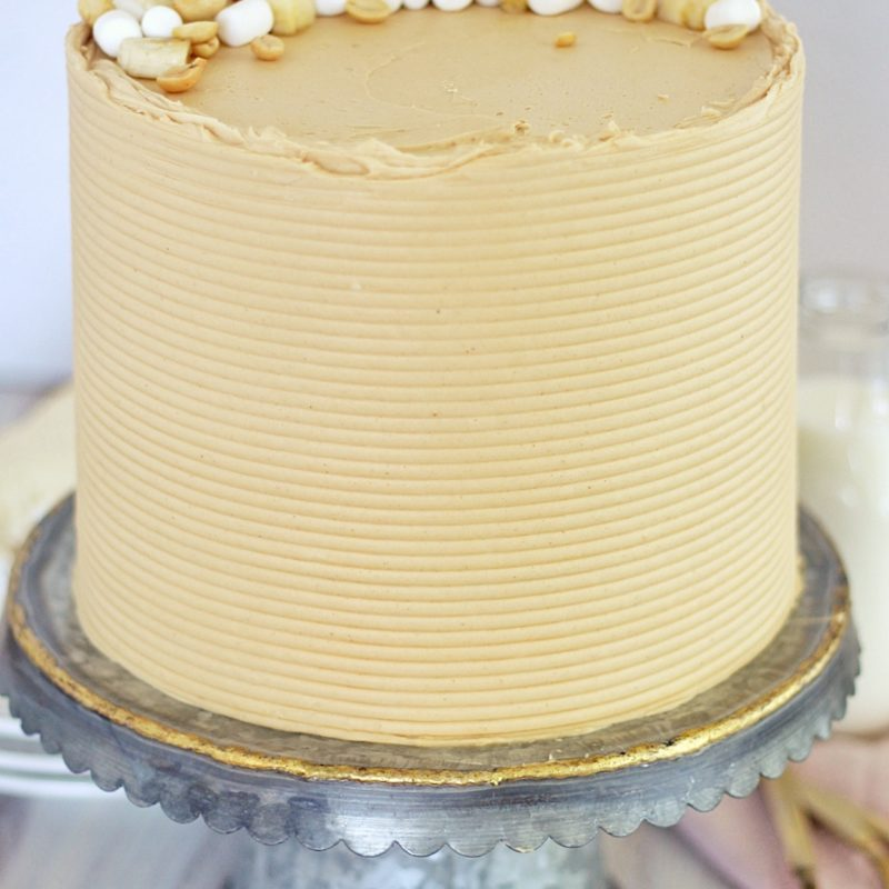 Fluffernutter Cake - tender white cake layers with banana cream filling, toasted marshmallow filling and peanut butter buttercream #fluffernutter #fluffernuttercake #cakerecipe #peanutbutterdessert #peanutbutterbuttercream #thebestpeanutbutterbuttercream #bananacream #bananapudding #cakebycourtney #layeredcake