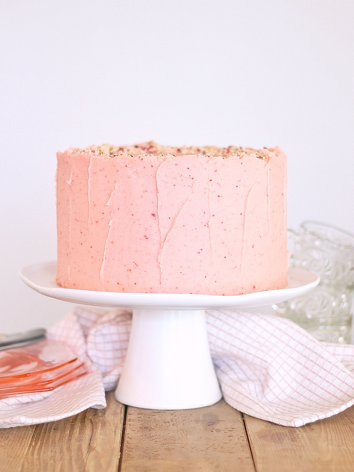 Strawberry Pretzel Delight Cake - tender yellow cake layers with strawberry buttercream and a strawberry pretzel crunch filling. #cakebycourtney #cakerecipe #summercakerecipe #summerdessert #yellowcake #strawberrybuttercream #strawberrycake #strawberrypretzeldelightcake