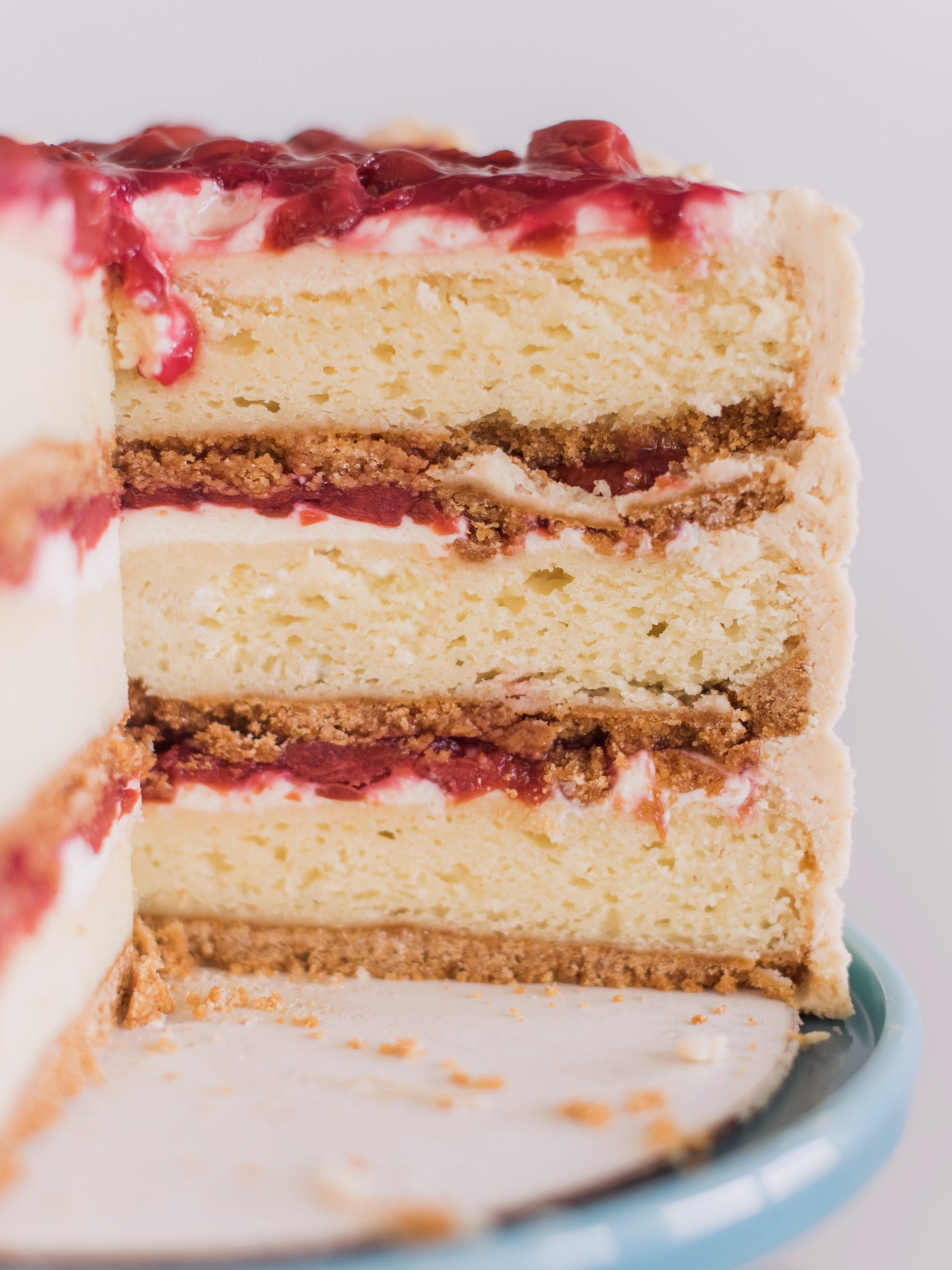 Cherry Cheese Pie Cake - dig into this delicious pie-inspired cake with layers of graham cracker, cream cheese cake, cheesecake filling, cherry pie filling and graham cracker buttercream. #cakebycourtney #cherrycheesepiecake #cherrypie #cherrycheesepie #bestsummercakerecipes #summercakerecipe #bestcakerecipes #summercakes #cherrypiecake #cherrydessert #summerdessert #howtomakebuttercreamfrosting #howtomakecake
