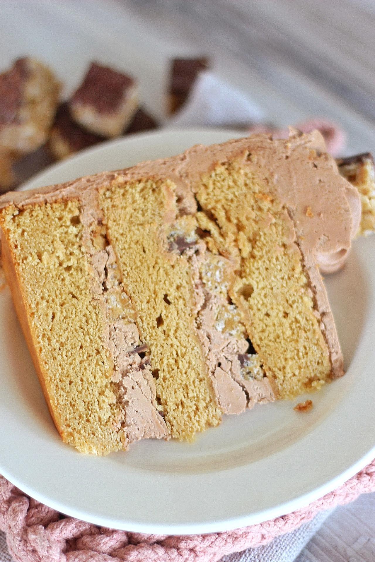 Scotcheroo Cake - caramel peanut butter cake layers with chocolate butterscotch buttercream #cake #cakerecipe #scotcheroo #scotcheroocake #scotcheroorecipe
