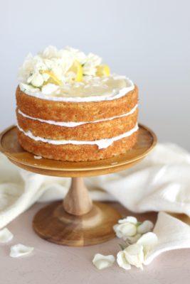 Sweet Laurel Bakery Fluffy Lemon Coconut Cake - lemon coconut cake layers, coconut spread and lemon curd #grainfreecake #dairyfreecake #refinedsugarfreecake #healthycake #lowsugarcake #glutenfreecake #glutenfreedessert #sweetlaurelbakery #lemoncoconutcake #lemoncurd #cakebycourtney