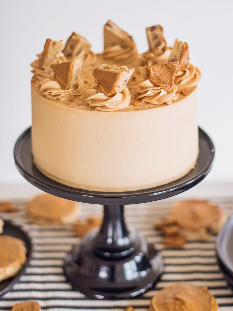 This cake celebrates the rich flavor and crumbly texture of biscoff. www.cakebycourtney.com