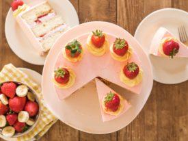 Strawberry Banana Milkshake Cake - light and fluffy banana cake layers with a strawberry cream filling and vanilla buttercream. #bananacake #strawberrycreamfilling #vanillabuttercream #strawberrybananacake #strawberrybananamilkshakecake #howtocakeit #cakerecipe #frostingrecipe #buttercreamrecipe