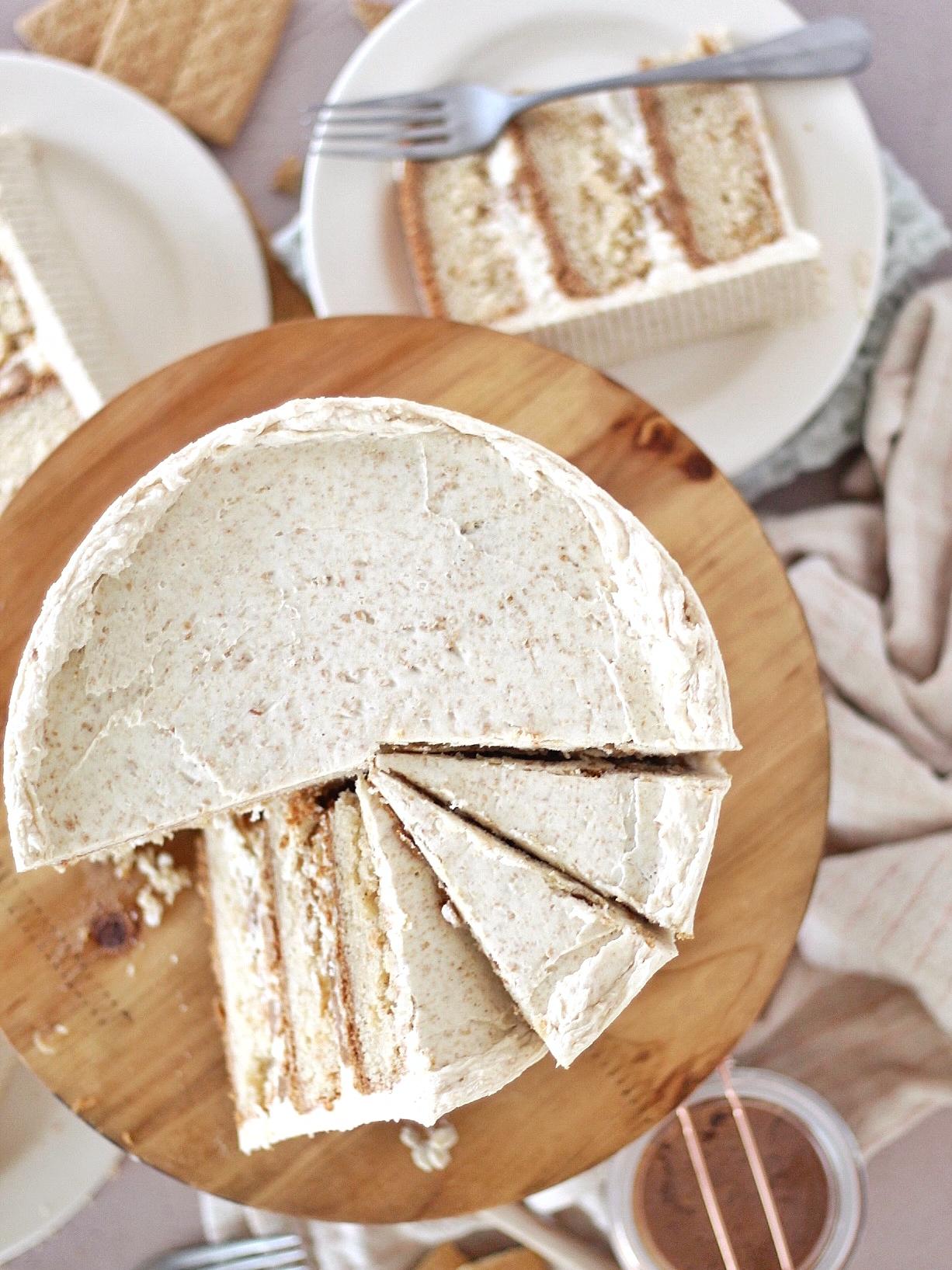 Graham Slam Cake - graham cracker cake layers baked on a graham cracker crust with graham cracker butter swirled in vanilla buttercream, covered in graham cracker buttercream. #cakebycourtney #grahamcracker #grahamcrackerdessert #grahamcrackercake #grahamcrackerbuttercream #cookiebutter #grahamcrackerbutter #buttercreamrecipe #cakerecipe #buttercream #howtomakebuttercreamfrosting #howtomakecake #cakeforbirthday #homemadefrosting #icingrecipe #homemadecakerecipe #howtocakeit #howtobakeacake #howtobake #dessert #dessertideas #cakeideas