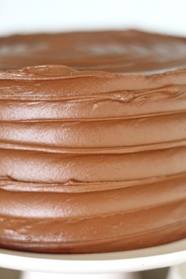 The Most Delicious Chocolate Cake - rich, moist and decadent chocolate cake layers with silky smooth chocolate buttercream #chocolatecake #bestchocolatecake #favoritechocolatecake #easychocolatecake #easychocolatecakerecipe #chocolatecakerecipe #chocolate #chocolateicing #icingrecipe #frostingrecipe #chocolatefrosting #chocolatefrostingrecipe #chocolatecakeeasy #howtomakecake #howtomakechocolatecake #birthdaycake #howtomakebuttercreamfrosting