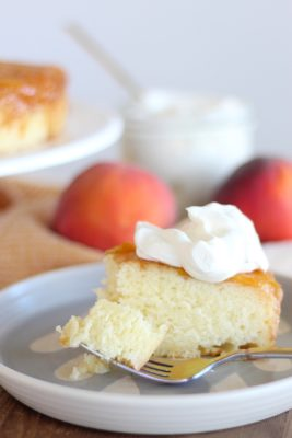 Peach Upside Down Cake with a whipped cream topping