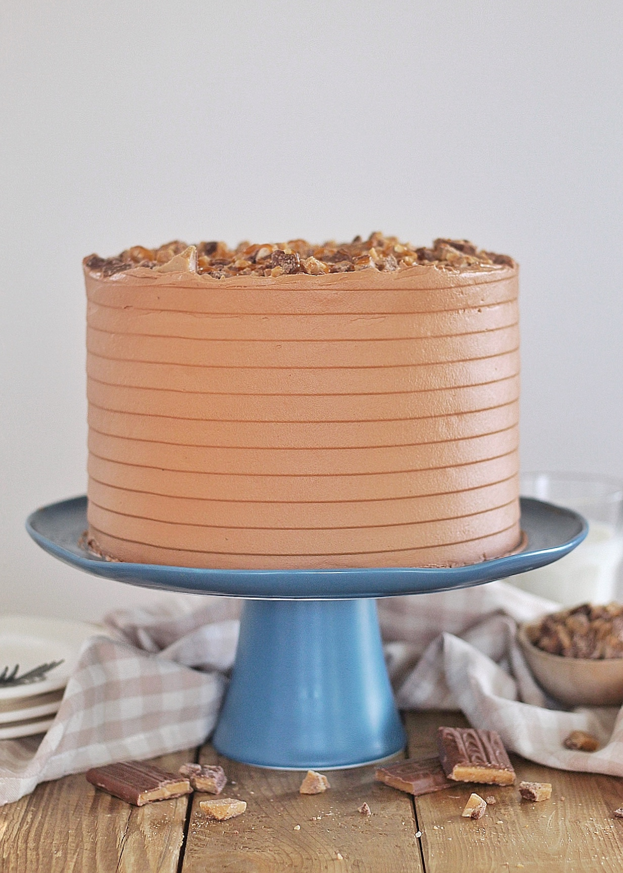 Better Than Anything Cake - also known as Better Than Sex Cake, this chocolate cake is next level with salted caramel soaked into the layers and whipped cream, toffee candy and chocolate caramel buttercream stacked on top! #betterthananythingcake #betterthansexcake #chocolatecake #chocolatebuttercream #bestchocolatecake